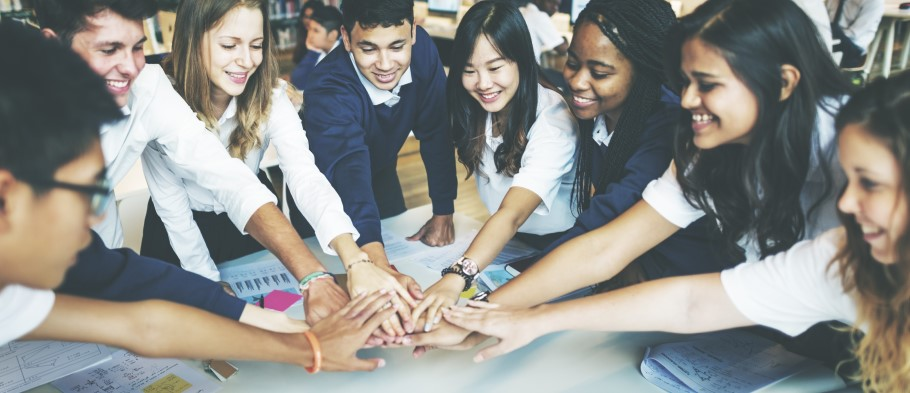 Image of a group of students in a classroom discussing student support